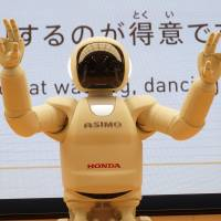 Asimo the robot shows off its many moves at a recent demonstration at Honda Motor Co. headquarters in Tokyo.   KAZUAKI NAGATA