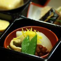 A bento (boxed meal) is served for lunch at Kikunoi during the same tour.