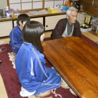 A 92-year-old man raising two of his orphaned grandchildren talks to reporters at his home in Kamaishi, Iwate Prefecture, on Feb. 27. | KYODO