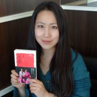 Hayashi holds a copy of her documentary book 'Human Dignity' in Tokyo on March 6. | KYODO