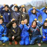 Members of the women's soccer team at Nippon Sport Science University pose with grapefruits they received as gifts through the 'sashiire' social gift-giving service in February. | KYODO