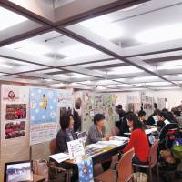At a recent job fair, consultants from the Tokyo Metropolitan Government and the city of Fuchu, western Tokyo, advise people interested in working at nursery schools. | WEDGE