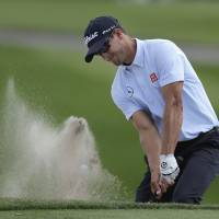 Down and dirty: Adam Scott hits out of a sand trap during the second round of the Arnold Palmer Invitational on Friday. | AP