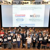 Participants in the 5th Japan Times Spelling Bee pose for a group photo with Japan Times President Takeharu Tsutsumi before the contest. | YOSHIAKI MIURA