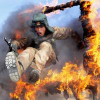 A frontier soldier from the People's Liberation Army undergoes training in Heihe, Heilongjiang province, on China's border with Russia, on Wednesday. | REUTERS