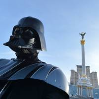 A Ukrainian Internet Party leader wears a Darth Vader outfit in Independence Square in Kiev in this file photo. | AFP-JIJI