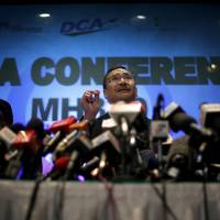 Malaysian Transport Minister Hishamuddin Hussein takes questions during a news conference about missing Malaysia Airlines Flight MH370 in Sepang on Thursday. | AP