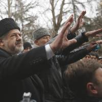Crimean Tatar leader Refat Chubarov addresses supporters during a protest in Simferopol, Ukraine, on Wednesday.   AP