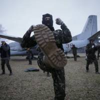 Members of a Maidan self-defense battalion train at a Ukrainian Interior Ministry base near Kiev on Monday. | REUTERS