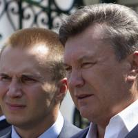 Ukraine's president at the time, Viktor Yanukovych (right), is pictured with his eldest son, Oleksandr, in April 2010. | REUTERS