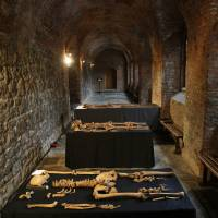 Skeletons from the 14th century that were discovered by construction workers under central London's Charterhouse Square lie on display. | AP