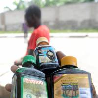 A vendor hawks bottles of locally made'Viagra' drink in Lagos on March 19. | AFP-JIJI