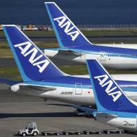 Part of All Nippon Airways Co.'s fleet of passenger jets line the tarmac at Haneda airport in Tokyo in October. | BLOOMBERG