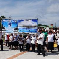 Islanders from Rongelap Atoll are seen in the Marshall Islands' capital, Majuro, on Saturday as they mark the 60th anniversary of the 1954 Bravo hydrogen bomb test at Bikini Atoll. | AFP-JIJI