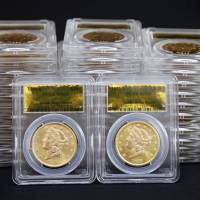 Rare U.S. gold coins found buried at the foot of a tree in California are displayed at Professional Coin Grading Service in Santa Ana on Feb. 25. | AP