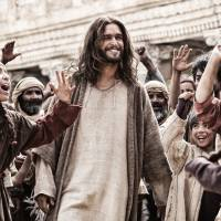 This image released by 20th Century Fox shows Diogo Morgado (center) playing the role of Jesus Christ in a scene from the film 'Son of God.'   | AP