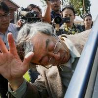 Dorian Nakamoto, identified by Newsweek magazine as the founder of bitcoin, exits his home in Temple City, California, on Thursday surrounded by members of the media. | BLOOMBERG