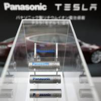 Lithium-ion batteries manufactured by Panasonic Corp. for the Model S electric vehicles built by Tesla Motors Inc. are displayed at Panasonic Center Tokyo last November. | BLOOMBERG