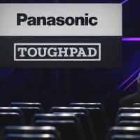 The logos of Panasonic Corp. and the company's Toughpad tablet are displayed prior to the unveiling event for the product in Tokyo on Feb. 24. | BLOOMBERG