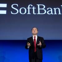 Masayoshi Son, the chairman, president and CEO of SoftBank Corp., addresses the Chamber of Commerce in Washington, D.C., on March 11. | BLOOMBERG