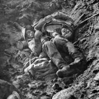In this picture released by the International Contemporary Documentation Library, dead French and German soldiers lie in a trench after a fight to the death in October 1916.   AFP-JIJI