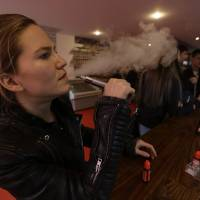 The Henley Vaporium in New York is peddling e-cigarettes to 'vapers' in a growing movement that now includes celebrity fans and YouTube gurus, online forums and 'vapefests' worldwide. | AP