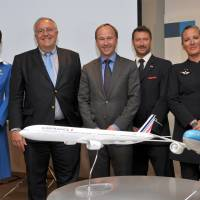 Air France-KLM Group Executive Vice President Patrick Alexandre (second from left) poses after a news conference in Tokyo on Wednesday. | YOSHIAKI MIURA