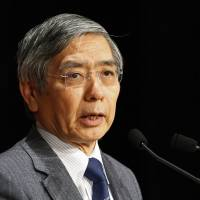 Bank of Japan Gov. Haruhiko Kuroda speaks at a seminar in Tokyo on Thursday. | REUTERS