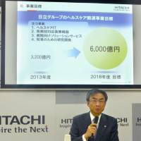 Masahiro Kitano, who will become senior vice president and chief of the health care business at Hitachi Ltd. in April, speaks at a news conference Monday in Tokyo. | KYODO