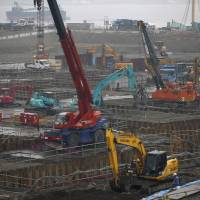 Heavy machinery is seen at a Tokyo construction site Thursday. Core machinery orders rose in January. | REUTERS