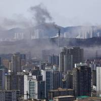 Smoke billows from a plant near a Pyongyang residential district in April 2012. | REUTERS