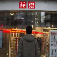 A shopper enters Fast Retailing Co.'s Uniqlo Lee Theatre flagship store in Hong Kong on Jan. 27. | BLOOMBERG