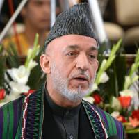 Afghan President Hamid Karzai speaks during official Nawroz festivities at the Presidential Palace in Kabul on Thursday.  | AFP-JIJI