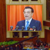 Chinese Premier Li Keqiang is displayed on a screen during the opening session of the 12th National People's Congress in Beijing in March 2013.   AFP-JIJI