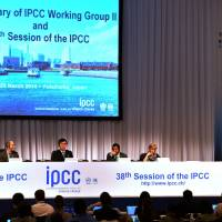 Environment Minister Nobuteru Ishihara (third from left) delivers a speech at the opening session of the Intergovernmental Panel on Climate Change Working Group II in Yokohama on March 25. | AFP-JIJI