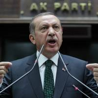 Turkish Prime Minister Recep Tayyip Erdogan addresses the members of his Islamic-rooted party in parliament in Ankara last June. | AP