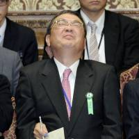 Handy man: Newly appointed NHK President Katsuto Momii is passed a note as he faces questions during a session of the Lower House Budgetary Committee in January. | KYODO