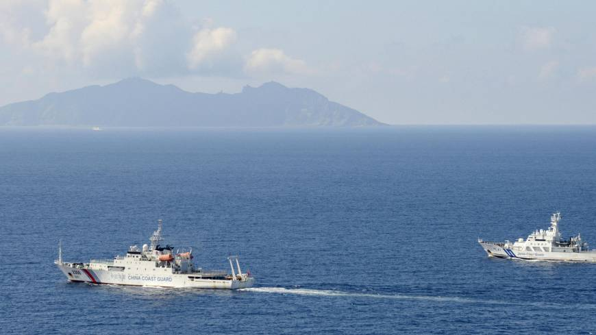 Race for resources: A Japan Coast Guard patrol ship (right) confronts a China Coast Guard boat in Japanese territorial waters near Uotsuri, one of the five main islands in the Japanese-controlled Senkaku group, in the resource-rich East China Sea last September.