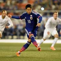 On target: Shinji Kagawa takes a penalty during Japan's 4-2 win over New Zealand on Wednesday at National Stadium. | AFP-JIJI