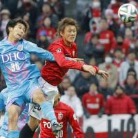 Closed doors: A banner bearing the words 'Japanese Only' was displayed at Urawa Reds' home game against Sagan Tosu at Saitama Stadium last Saturday. | KYODO