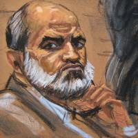 Suleiman Abu Ghaith is shown listening during his trial on terrorism charges in federal court in New York on Monday in this court sketch. | REUTERS