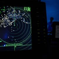 The navigational radar on an Indonesian National Search and Rescue boat is seen during the search for Malaysia Airlines Flight MH370 in the Andaman Sea area around northern tip of Indonesia's Sumatra island Monday. | AFP-JIJI