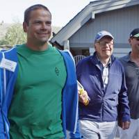 News Corp. Chief Executive and Chairman Rupert Murdoch, accompanied by his sons Lachlan (left) and James, attends the Allen & Co Media Conference in Sun Valley, Idaho, in July 2012. The media tycoon, 83, has brought Lachlan, his eldest son, back into the leadership of his empire and also promoted James, setting them up to succeed him.   REUTERS
