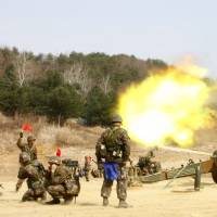 An artillery drill takes place in Inje, near the demilitarized zone that separates the two Koreas, in this picture provided by the South Korean Army and released by Yonhap new agency on Thursday. | REUTERS