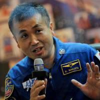 Japanese astronaut Koichi Wakata speaks behind a glass wall during a press conference at Kazakhstan's Baikonur cosmodrome on Nov. 6, 2013. Wakata on Sunday became the first Japanese to serve as commander of the International Space Station. | AFP-JIJI