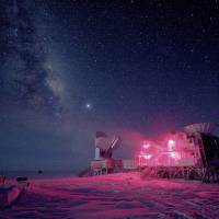 The 10-meter-wide South Pole telescope and the BICEP2 (Background Imaging of Cosmic Extragalactic Polarization) telescope at Amundsen-Scott South Pole Station is seen against the night sky with the Milky Way in August 2008. | REUTERS