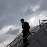 U.S. President Barack Obama departs Air Force One at Miami International Airport on Thursday. | AP