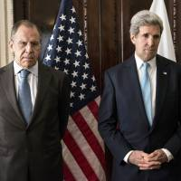 Russian Foreign Minister Sergey Lavrov (left) and U.S. Secretary of State John Kerry stand together before a meeting at Winfield House in London on Friday. | AFP-JIJI