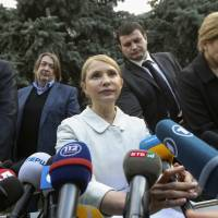 Former Prime Minister Yulia Tymoshenko (center) holds a news conference in Kiev on Thursday to announce she will run for president in Ukraine's May 25 election. | REUTERS