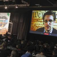 Former U.S. National Security Agency contractor Edward Snowden talks during a simulcast conversation during the South By Southwest Interactive Festival on Monday in Austin, Texas. | AP